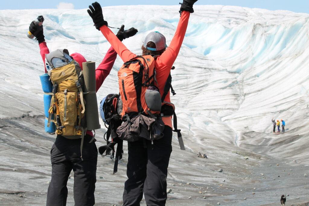 hikers climb a glacier in Wrangell-Saint Elias National Park And Preserve - Kennicott Wilderness