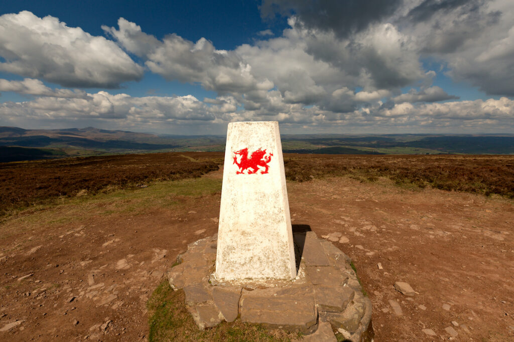 Landmarker on hill with Welsh Dragon.