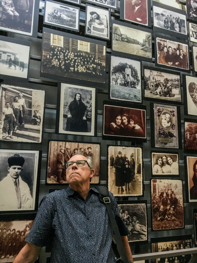 Man looking at the Village Photo Exhibition in US Holocaust Memorial Museum.
