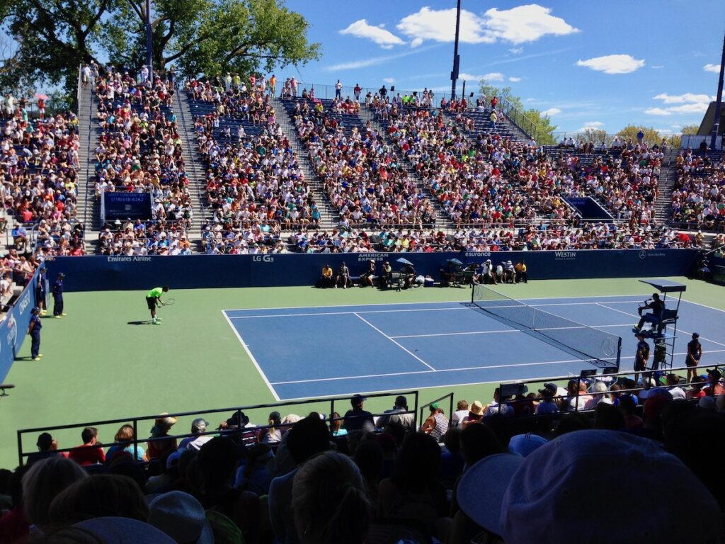 Tennis match on an outside court at the U.S. Open.
