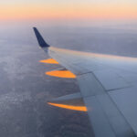 Photo out of airplane window during sunset.