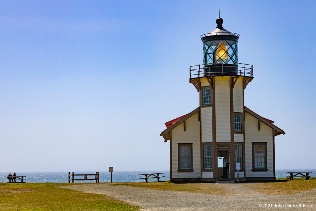 Lighthouse with light shining during daylight