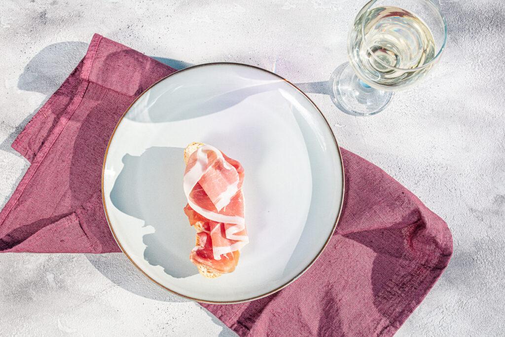 San Daniele ham with a glass of wine