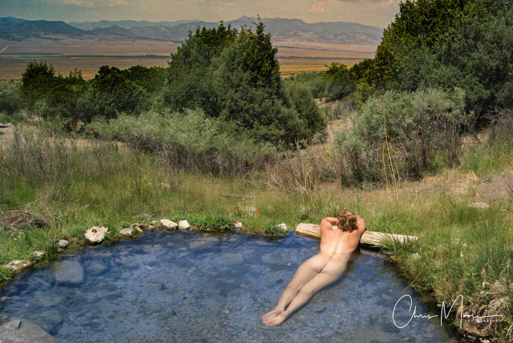 Woman relaxing in natural pool nude.