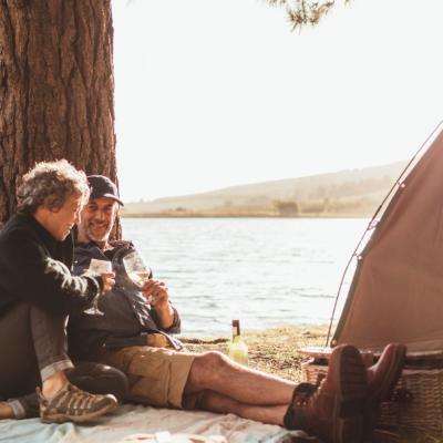 mature couple camping by lake