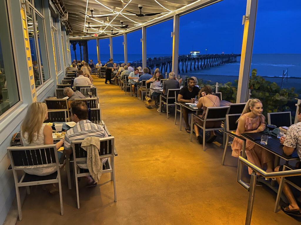 Outdoor patio dining at Fins Restaurant, Venice Beach, FL.