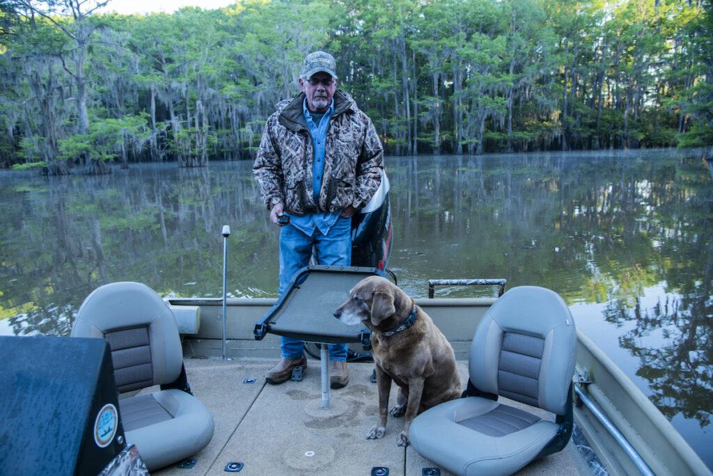 Jon Crawford and his dog, Mia, on Caddo Lake.