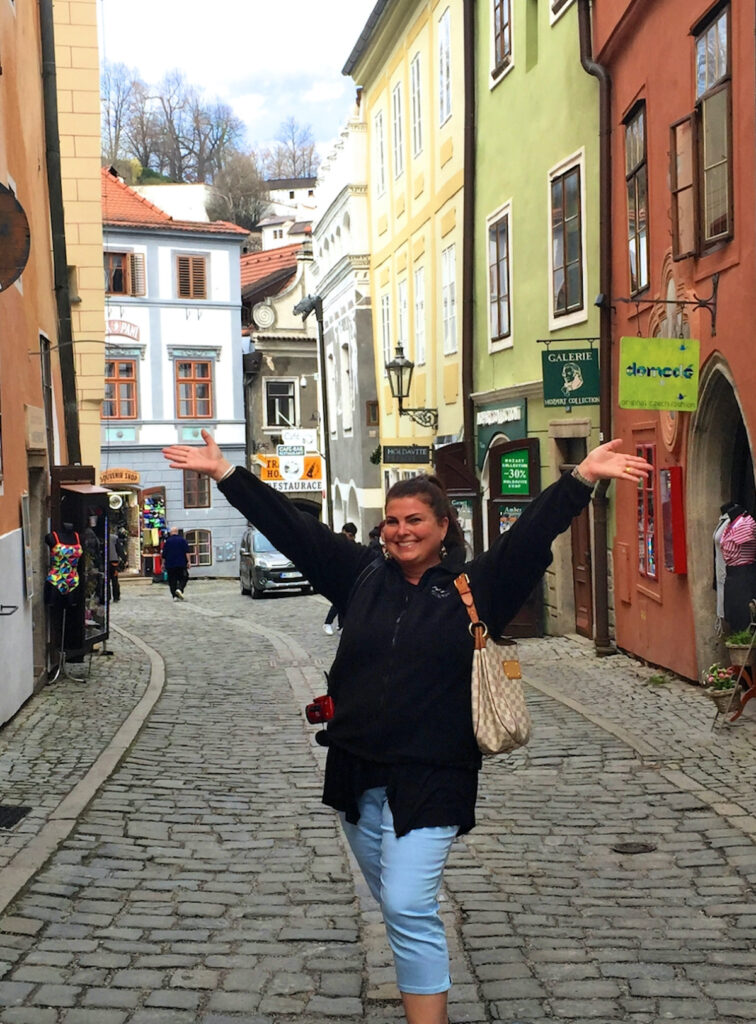 woman standing on cobbled streets of Bratislava