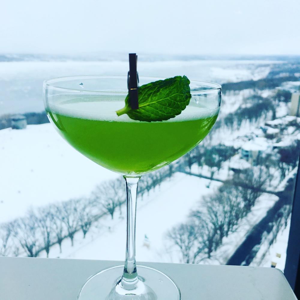 Green mint leaf cocktail on hotel ledge Quebec City
