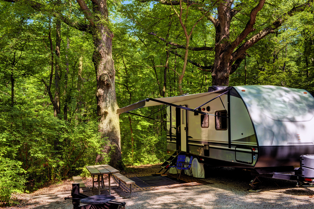 Travel trailer camping in the woods at Starved Rock State Park, Illinois.