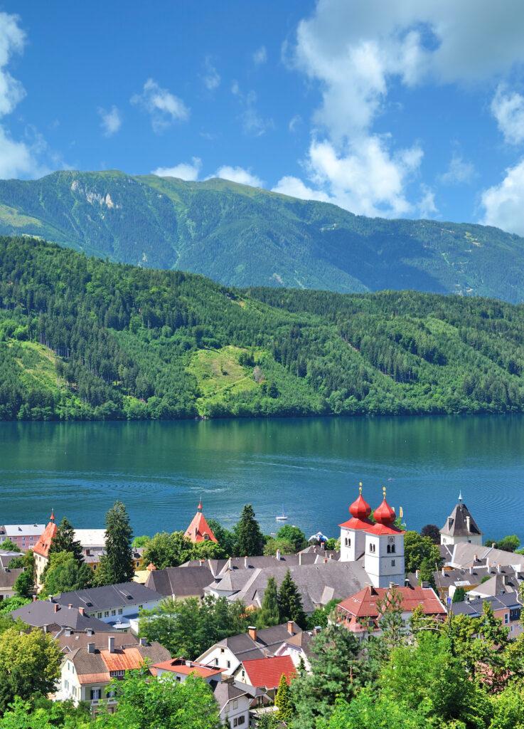 Village of Millstatt am See at the edge of Lake Millstatt, Carinthia, Austria.