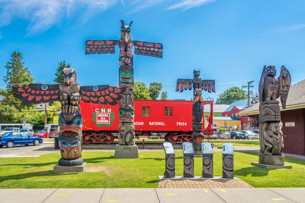"""View of totems in Duncan. Duncan is """"The City of Totems"""". The city has 80 totem poles around the entire town."""