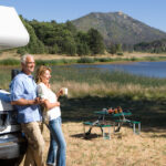 Mature couple RV camping by lake
