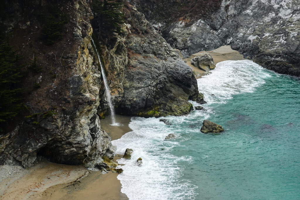 McWay Falls on the coast of Big Sur central California, flowing from McWay Creek in Julia Pfeiffer Burns State Park into the Pacific Ocean.