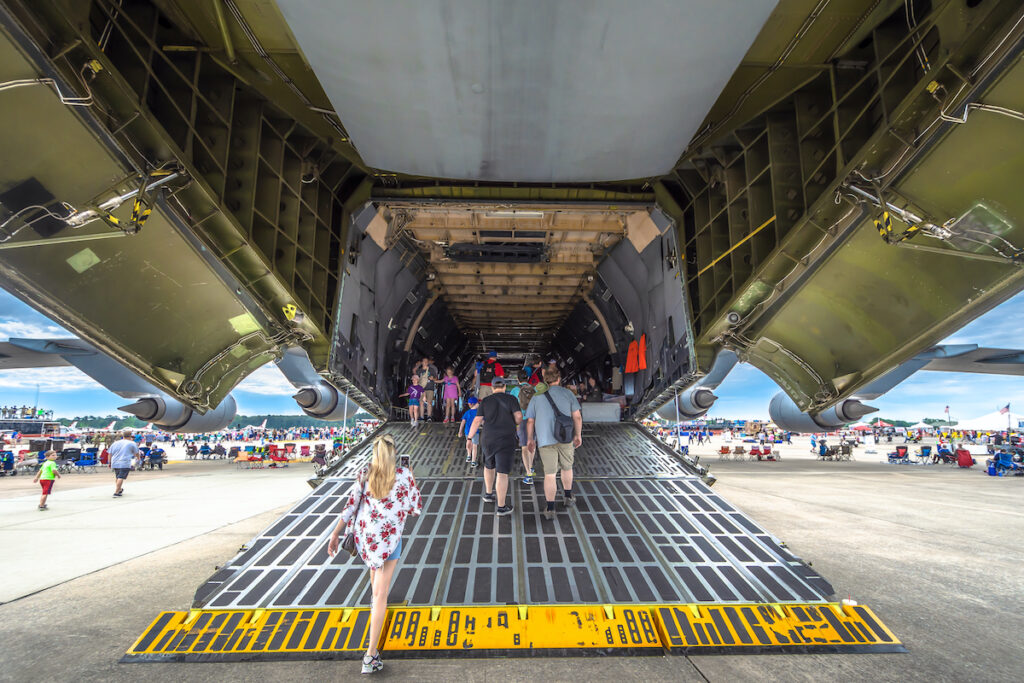 People walk into US Air force's airplane in Wings Over Wayne Air Show at Seymour Johnson Air Force Base.