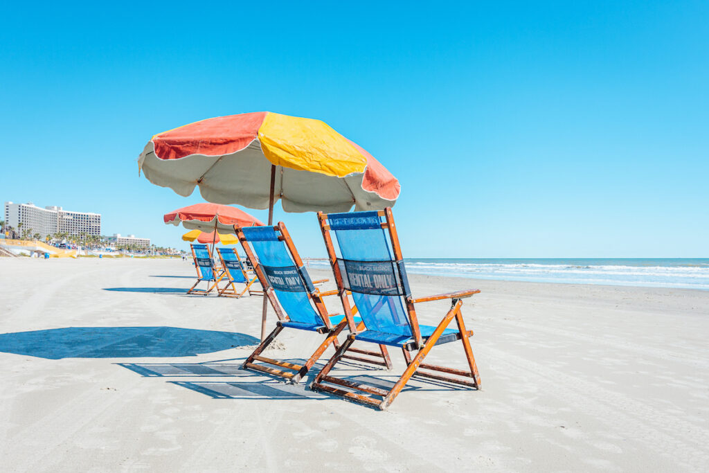 View of  colorful beach chairs and umbrellas on Galveston Island Texas.