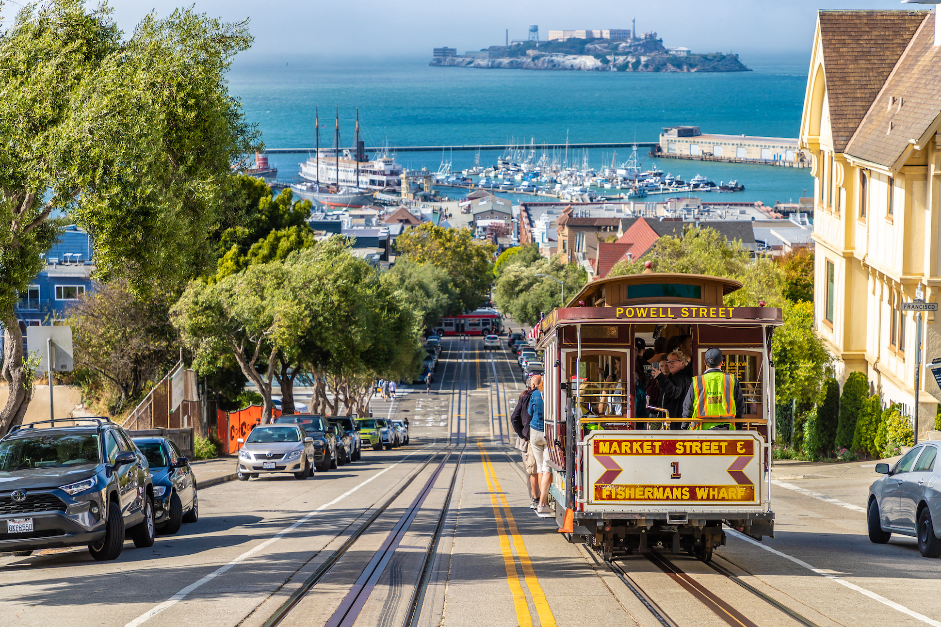 Cable car tram and Alcatraz prison island on a background in San Francisco, California, USA