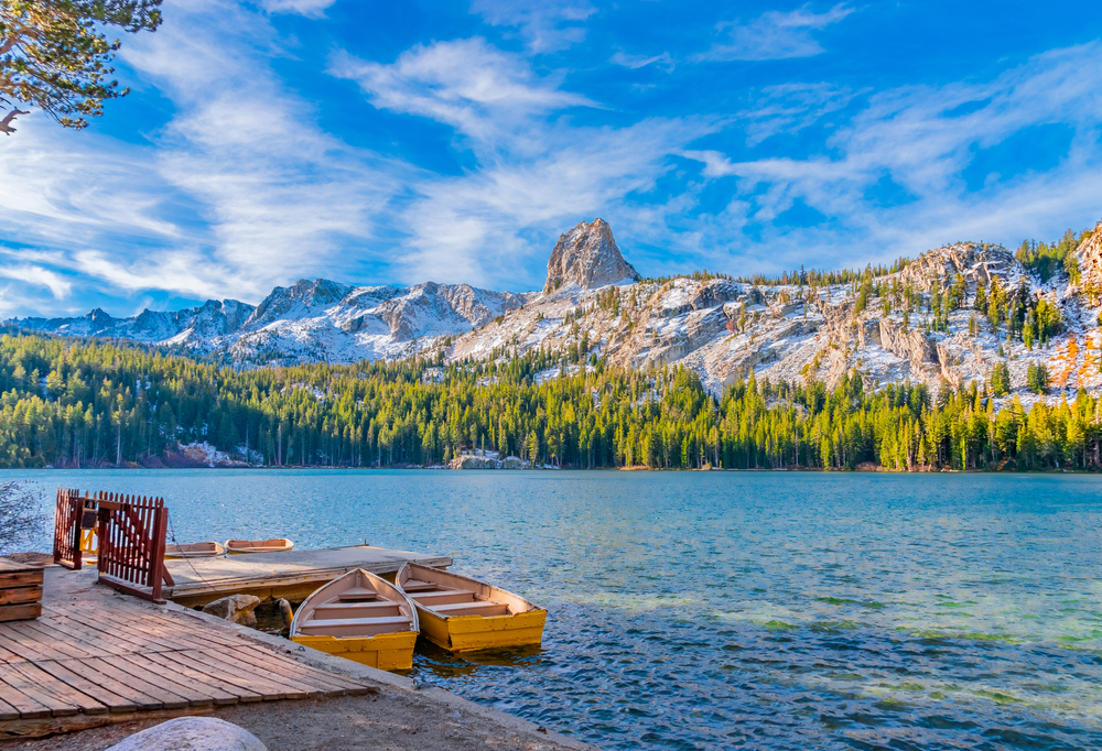 Boats sit at dock at Lake George under the watchful eye of the Crystal Crag peak. This peak is in Mammoth Lakes in Central California, in Sierra Nevada Mountains.