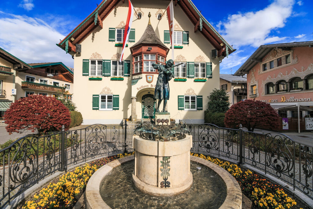 Town Hall of Saint Gilgen with the Mozart statue in front in downtown Sankt Gilgen.