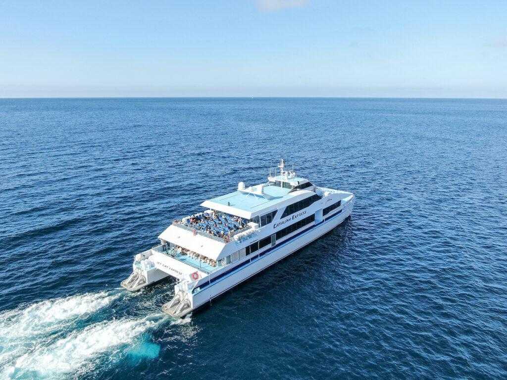 Aerial view of Catalina Express speedboat next to Santa Catalina Island.