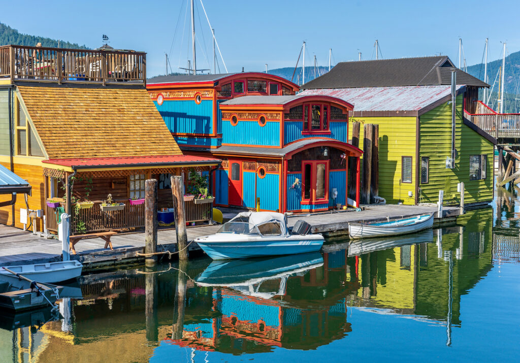 Colourful houseboats and boats on the ocean at Cowichan Bay, Vancouver Island, British Columbia, Canada.