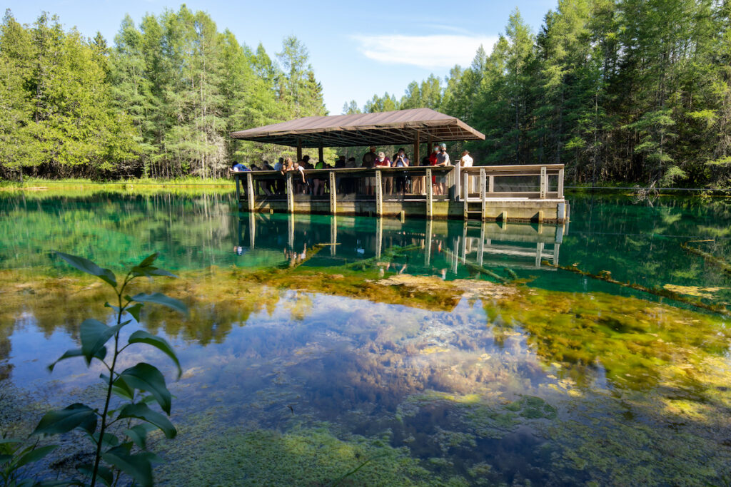 Dock and landscape of Kitch-iti-kipi, the Big Spring at Palms Book State Park, upper Peninsula.