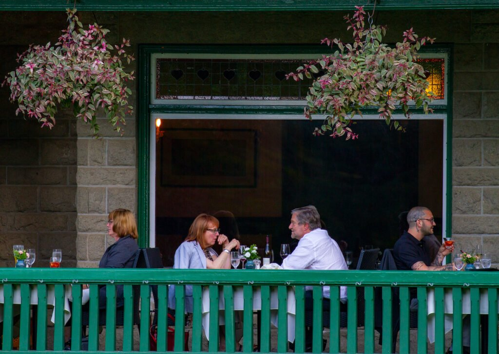 People enjoying restaurant at Butchart Gardens, Brentwood Bay, British Columbia, Canada.