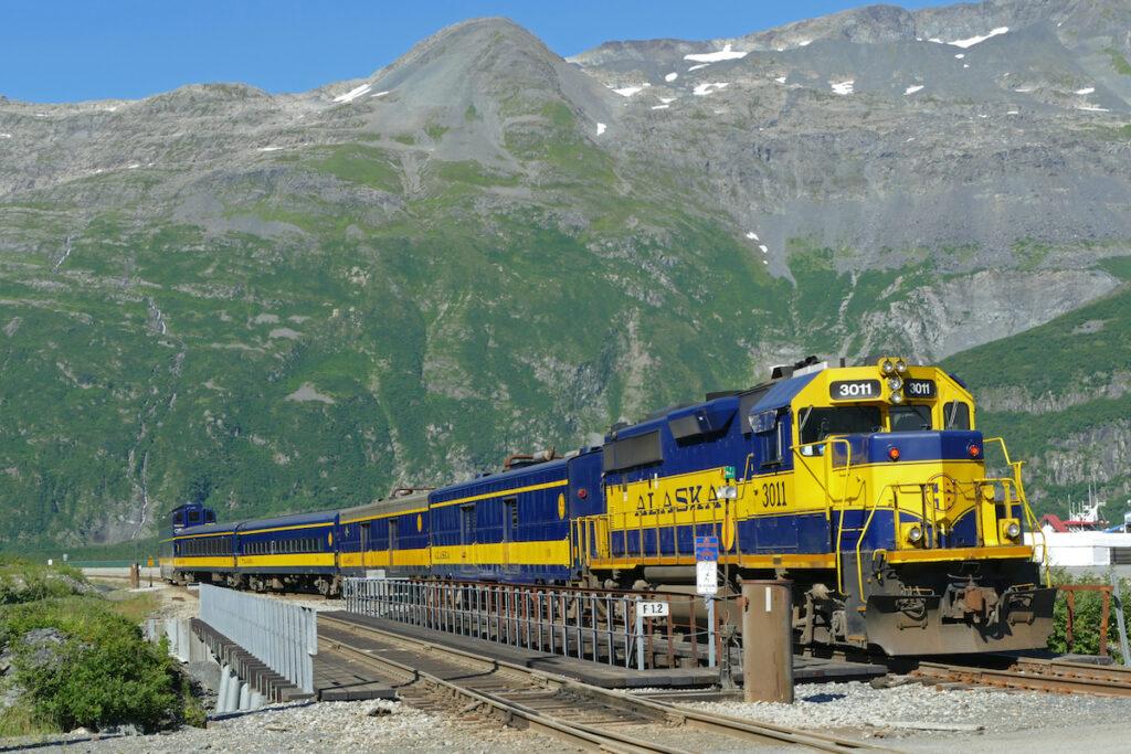 Railroad crossing and Alaska Railroad train in Kenai Peninsula.