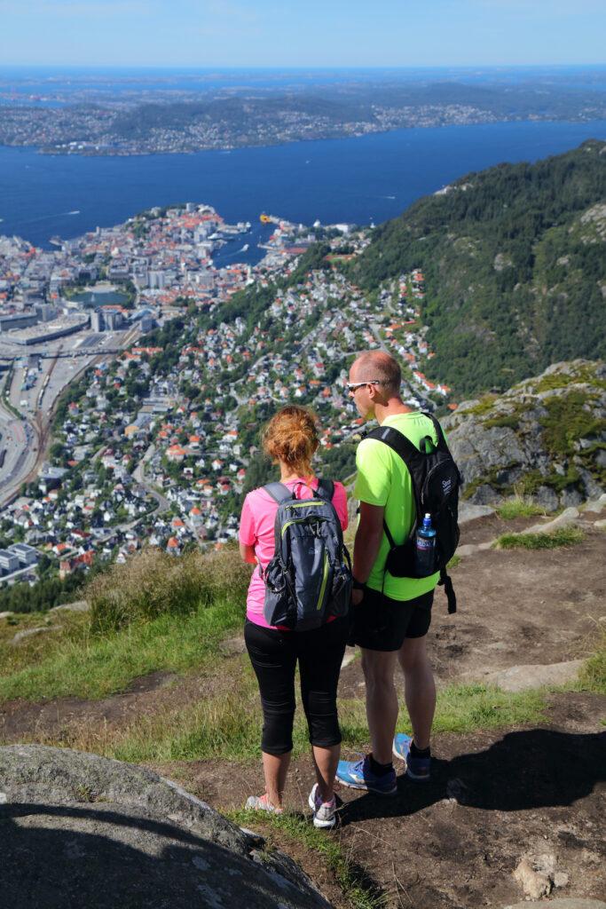 People hike Ulriken mountain trail overlooking city of Bergen, Norway.