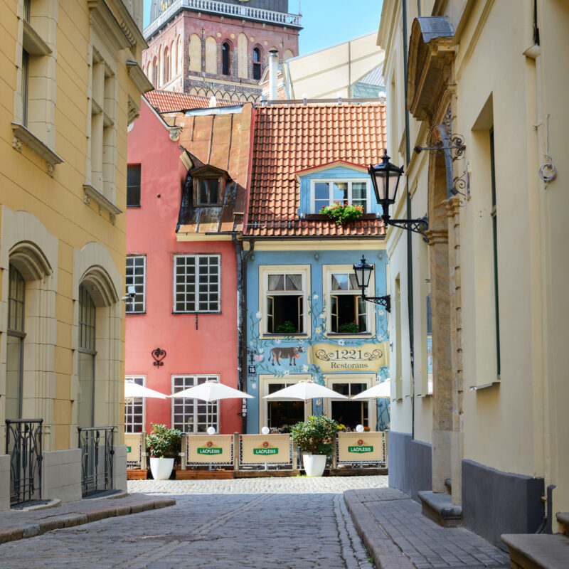 Riga, Latvia - August 10, 2015: Old street with cafes in Riga old center