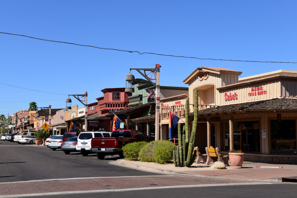 The old western styled buildings on E Main Street of Old Town Scottsdale, a popular attraction for tourists and locals.