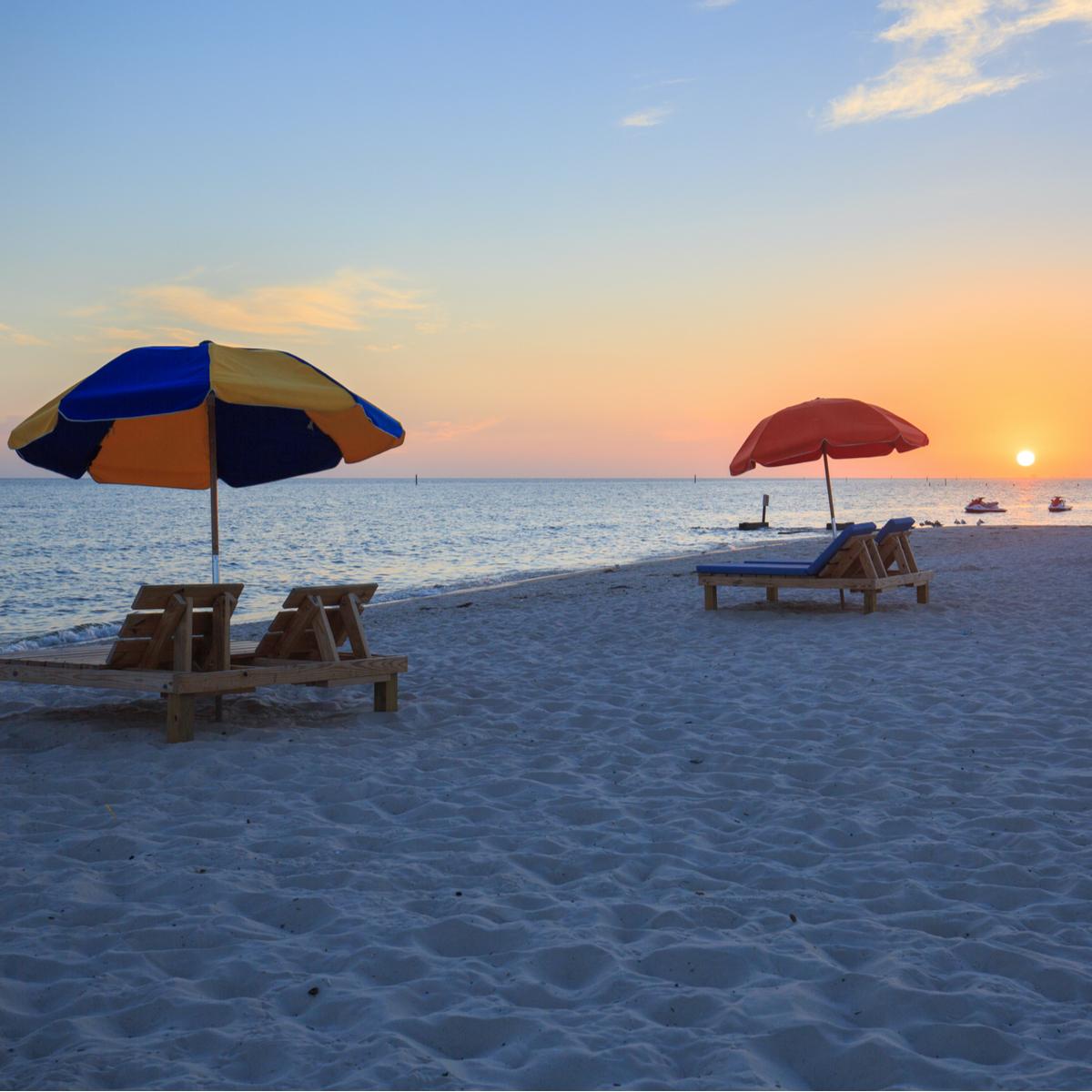 Sunset in Biloxi beach, Mississippi, along Gulf Coast shore.