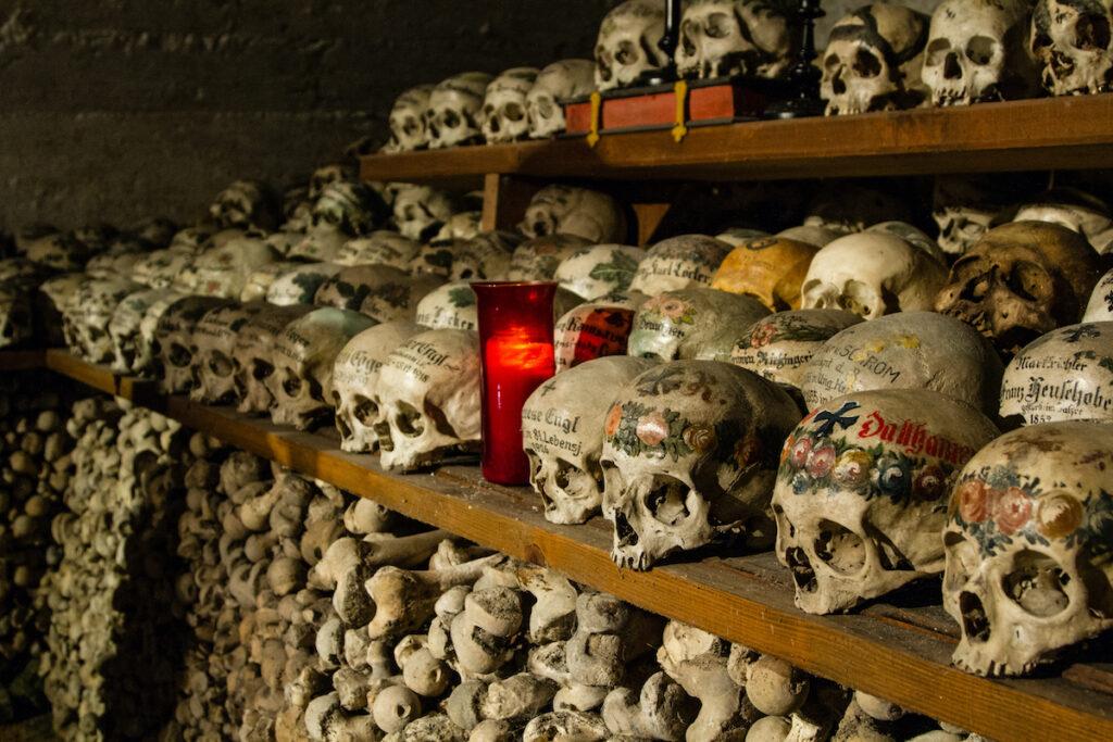 Painted skulls inside the Hallstatt Ossuary (also called Charnel House or Beinhaus).