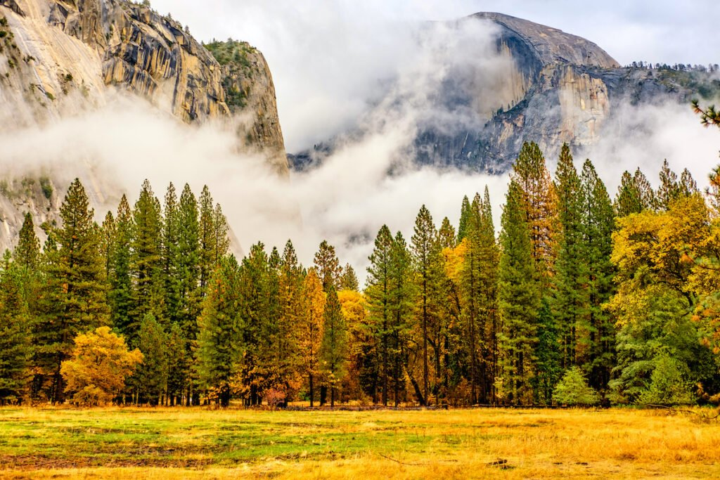 Yosemite National Park Valley at cloudy autumn morning. Low clouds lay in the valley. California, USA.