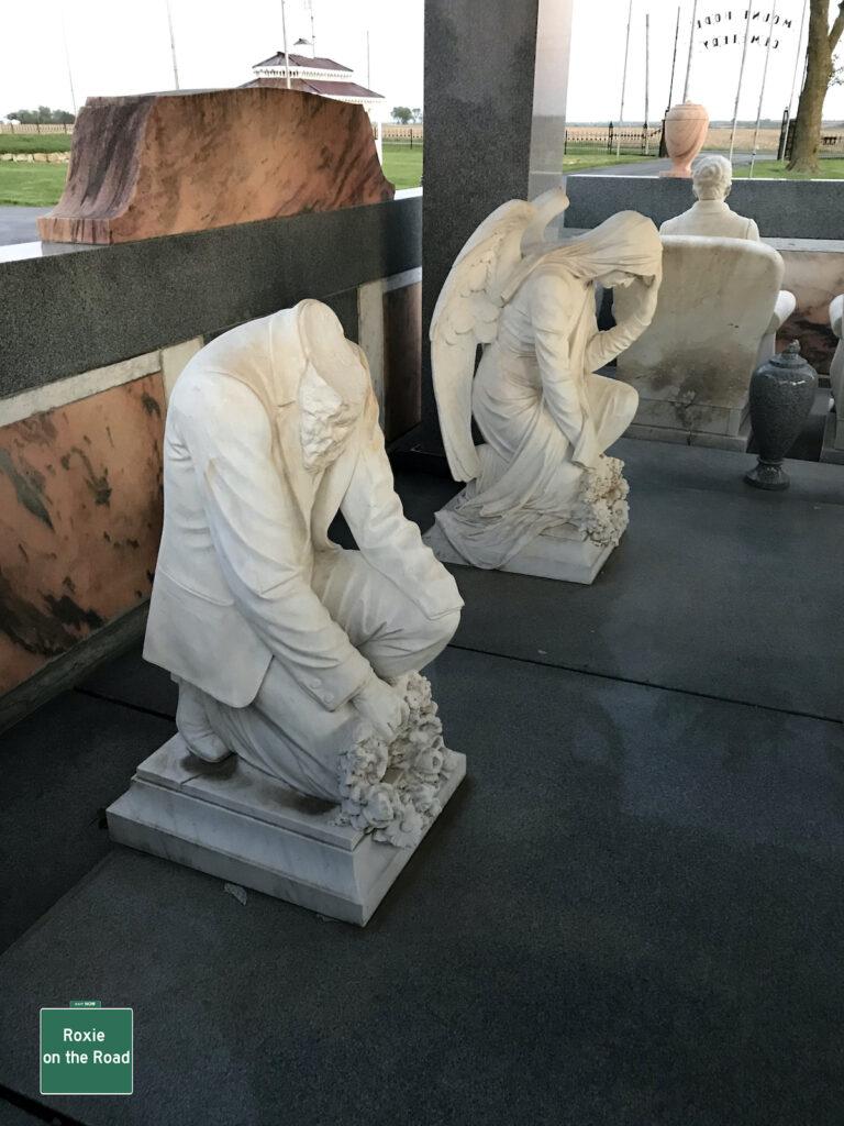 The decapitated kneeling John Davis and the angel.