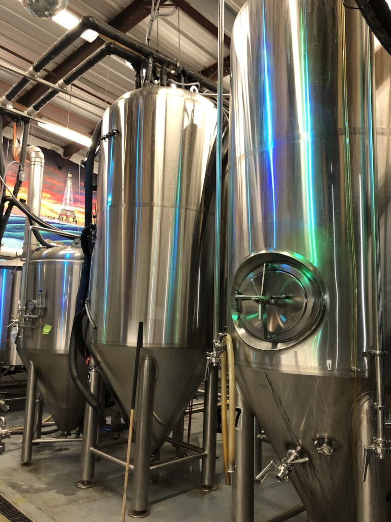 Different sized beer storage tanks.