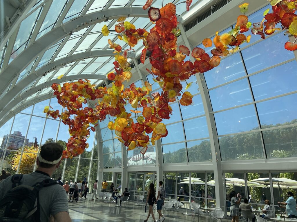 Visitors view the Chihuly Garden and Glass.