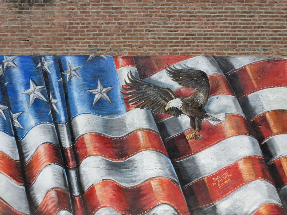 An American flag is one of the murals in downtown Winterset