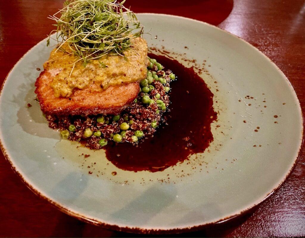 Aqua's salmon with pistachio crust, petite peas and quinoa.