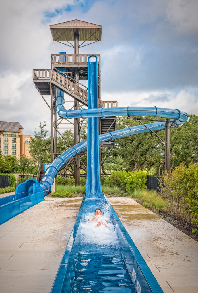 Man slides down the body slide at the River Bluff Experience, JW Marriott.