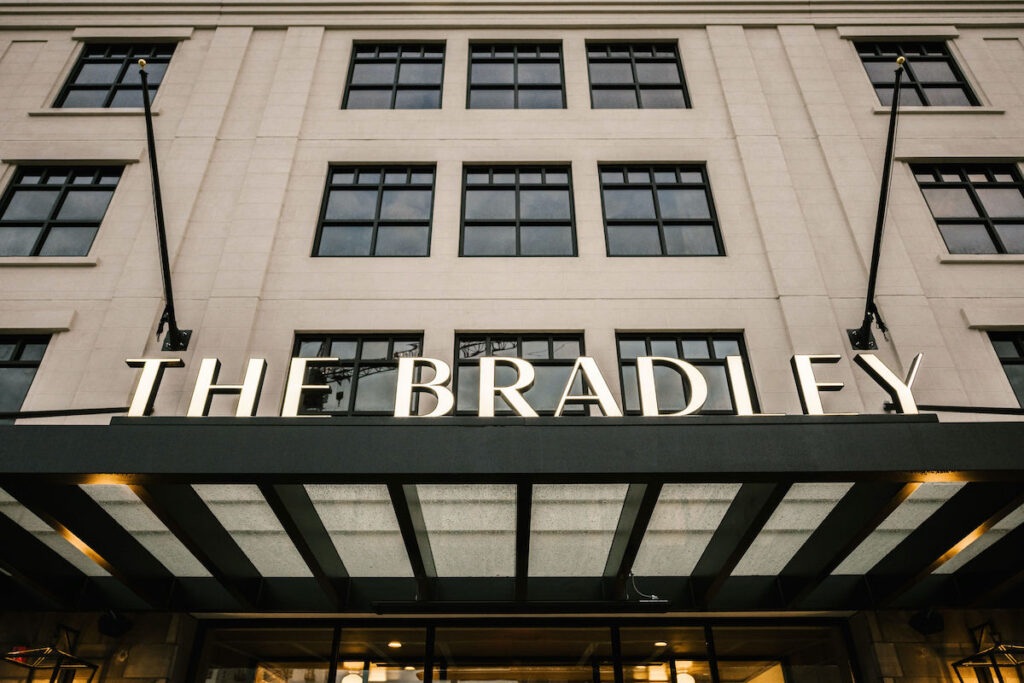 Outside sign and entrance to the Bradley Hotel.