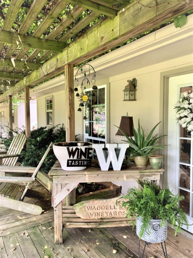 Waddell Vineyards porch with decorations plans and chairs.