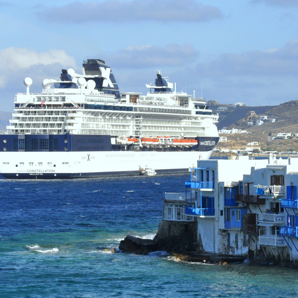 Celebrity Cruise ship by the harbour in Mykonos, Greece on the island.