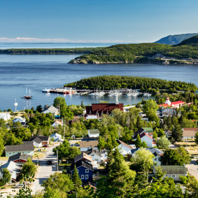 Aerial view of City of Tadoussac, Quebec, Canada. Saguenay river and St-Lawrence river.