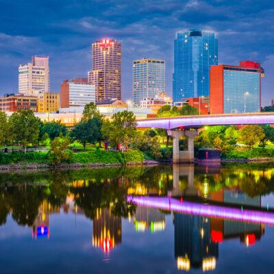 Little Rock, Arkansas, skyline on the river at twilight.