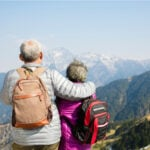 Rear view of senior couple watching the mountains