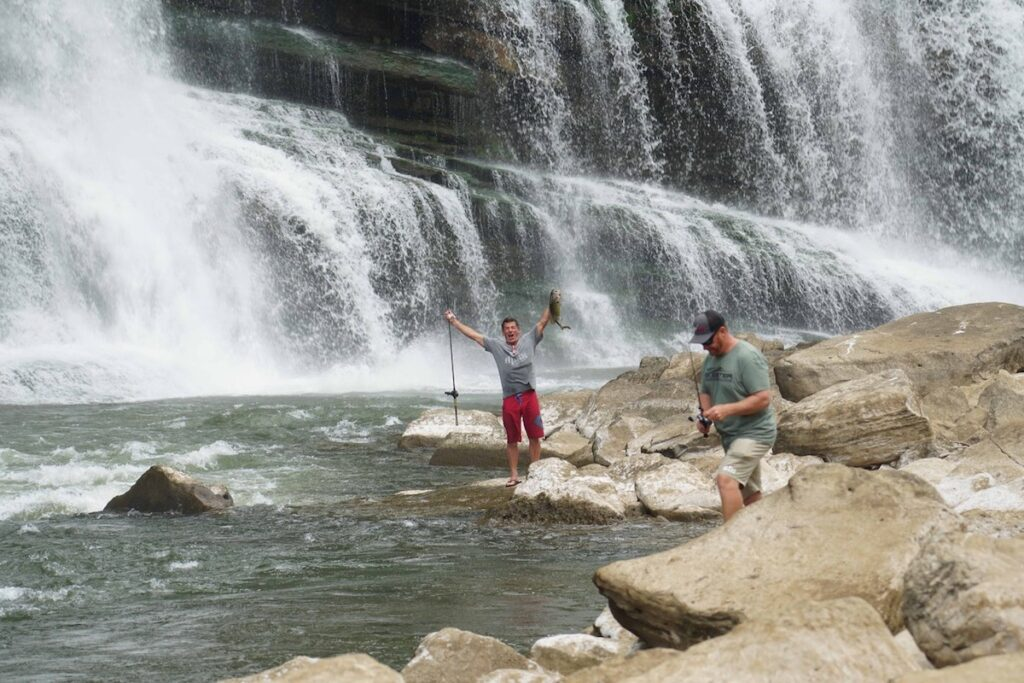 Man catching a fish in Rock Island State Park.