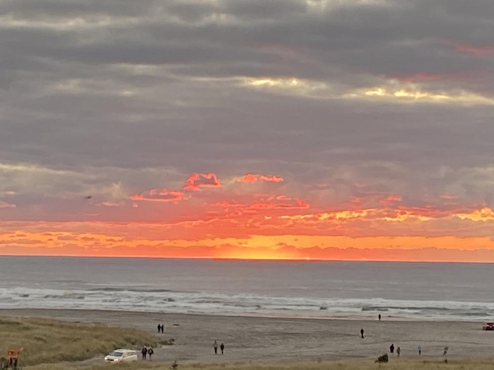 Fiery orange sunset over the Pacific in Long Beach, Washington