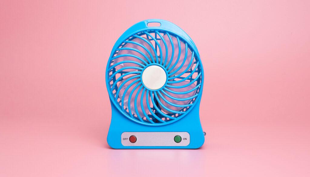 Blue fan on pink background
