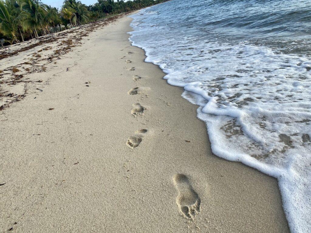 Footprints on a beach in Belize